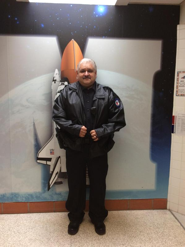 Officer Ramon in front of wall mural.
