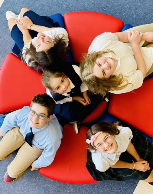 Legacy Preparatory Academy best charter school in Davis County, kids sitting in circle looking up
