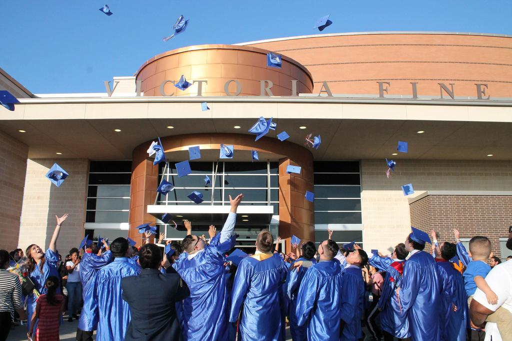 2018 Liberty Academy graduates tossing their hats in the air after the graduation ceremony