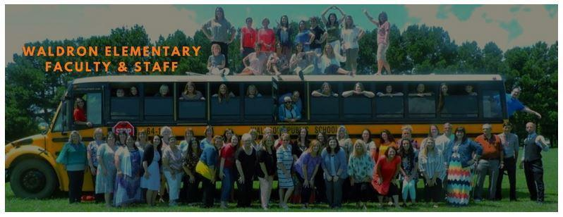 Waldron Elementary staff members pictured with a school bus