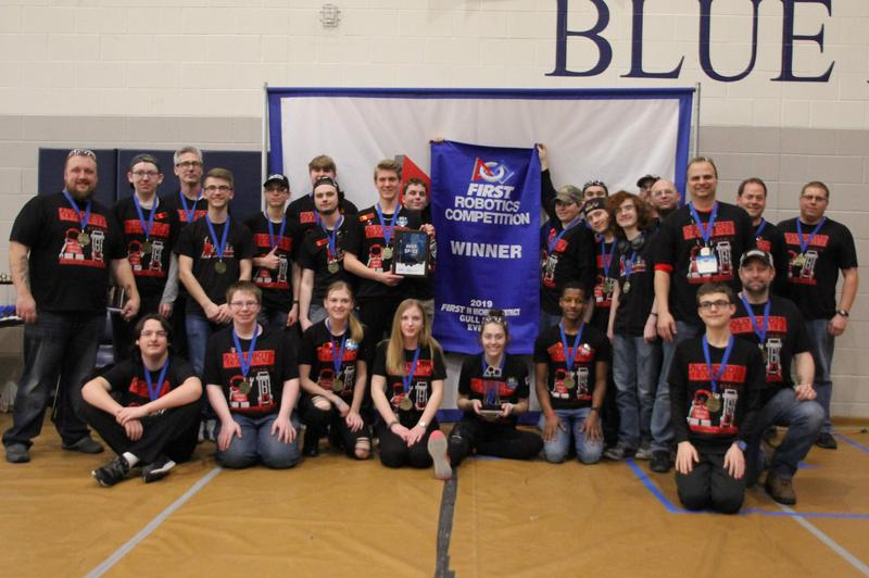 Team picture of Alotobots with blue banner