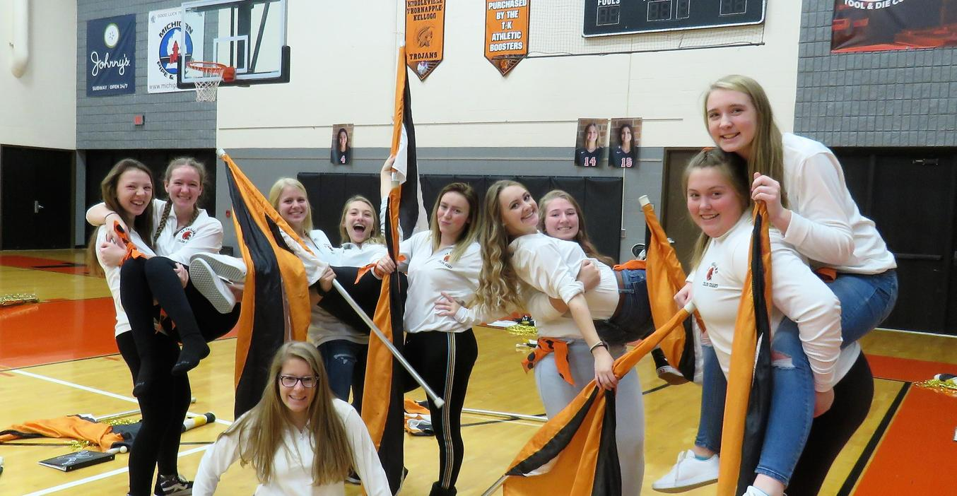 TKHS flag corp celebrates during an event at the high school.