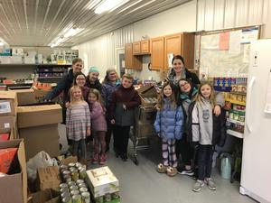 student council kids at the food pantry.
