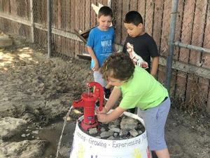 students using water pump