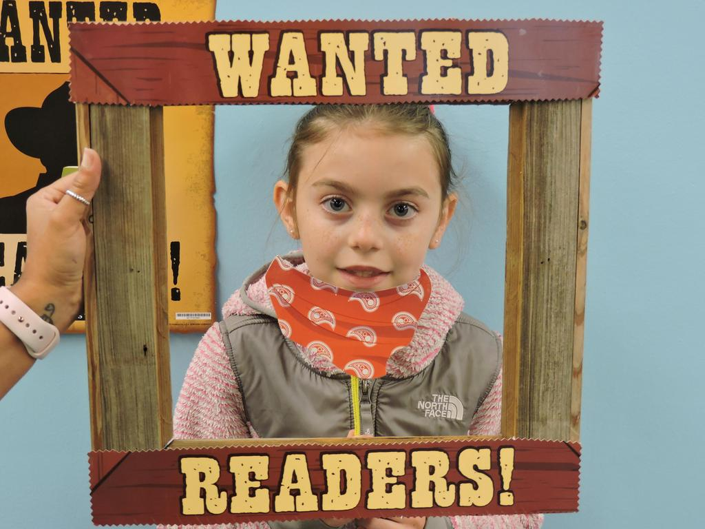 Student with Wanted Readers picture frame