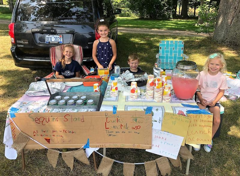 Four young TK students had a lemonade stand this summer and donated all proceeds to help students with negative lunch balances.