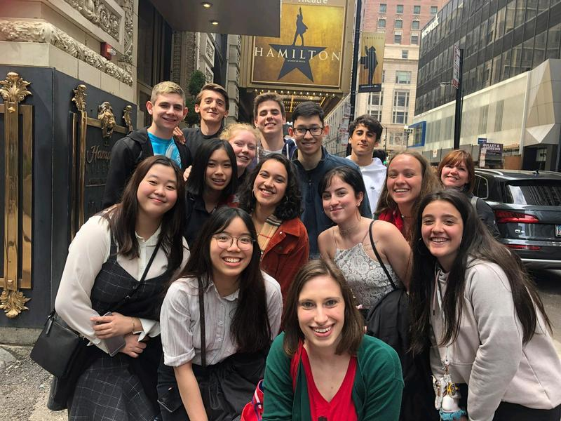 Students outside the theatre with the Hamilton sign