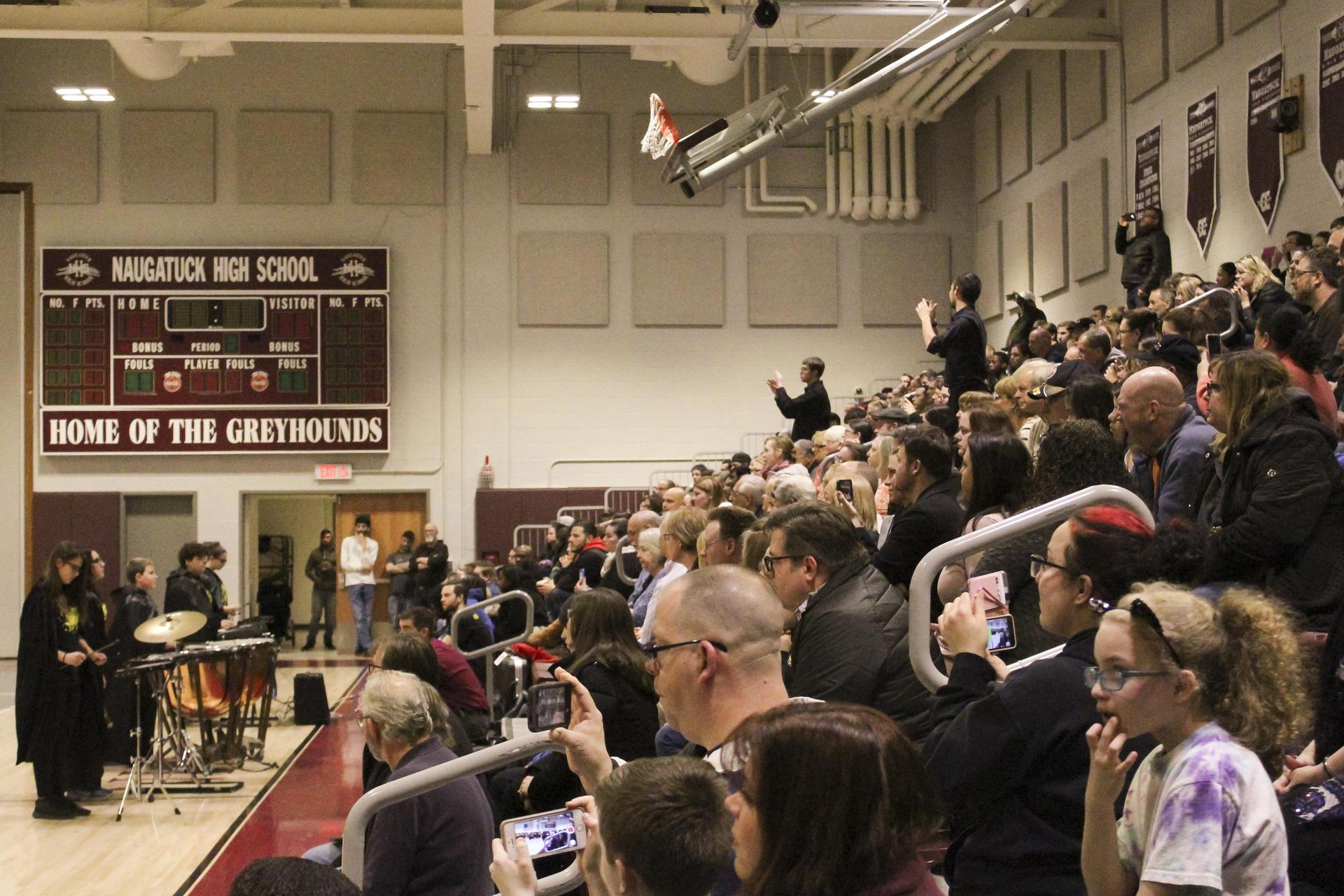 Audience listening to SoundSport musicians playing concert in high school gym