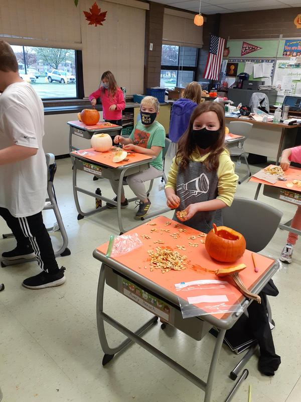 pic of students cutting up pumpkins