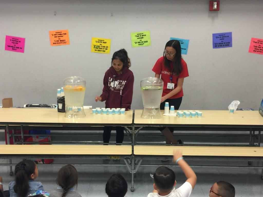 students dispensing water