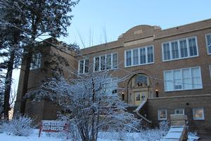 Image of district building in snow.