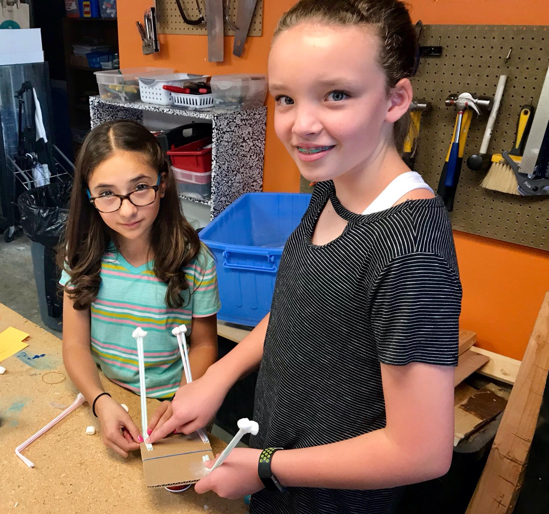 Middle school girls work on DareDevil Design project together