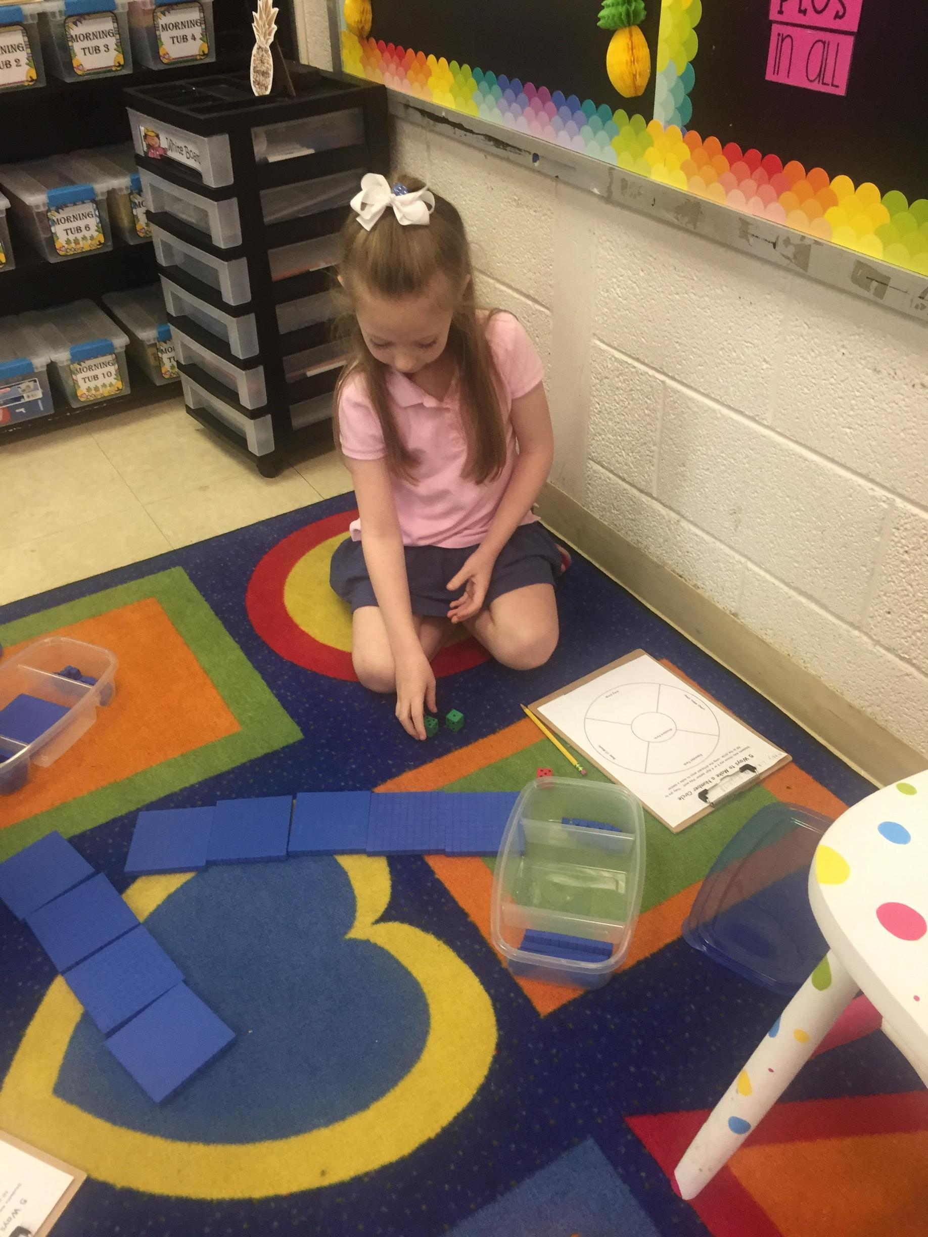 Second grade student working on a document independently
