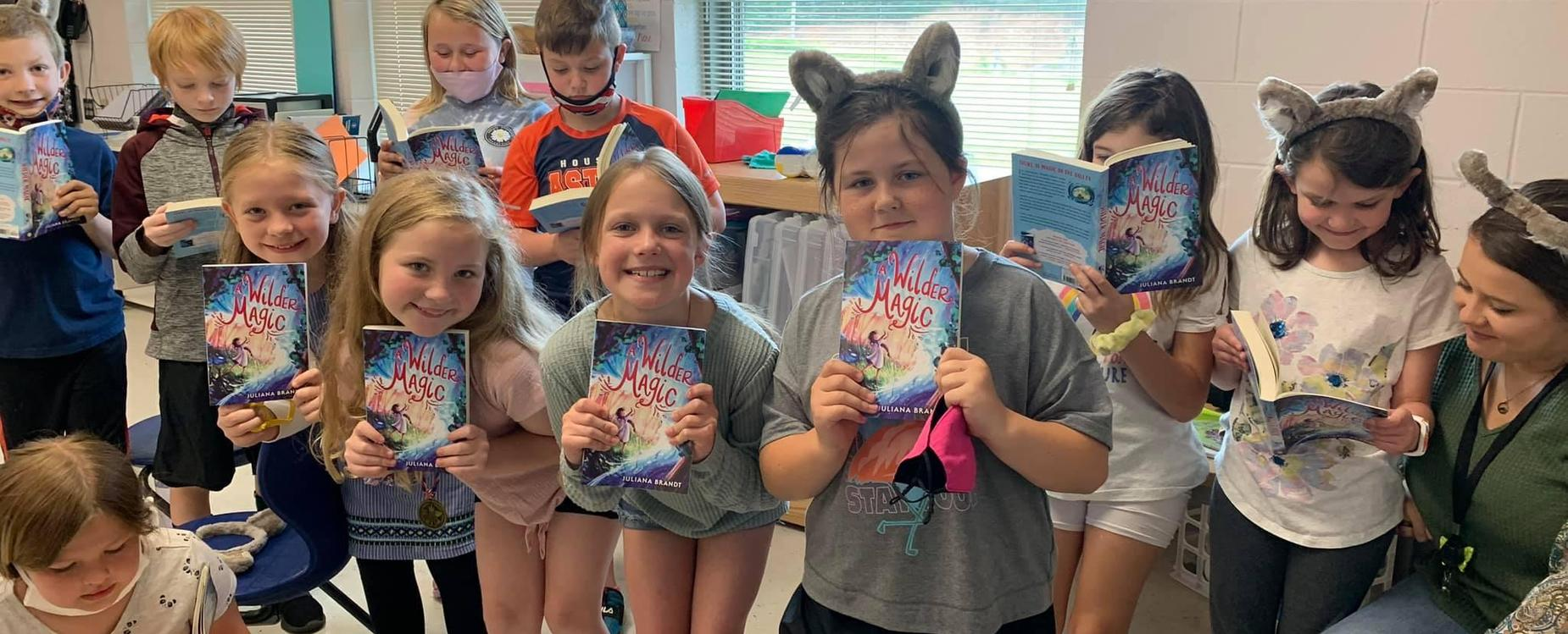 Students showing their books