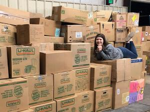 Abigail Redin with boxes of shoes