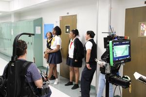 Film being shot in school hallway