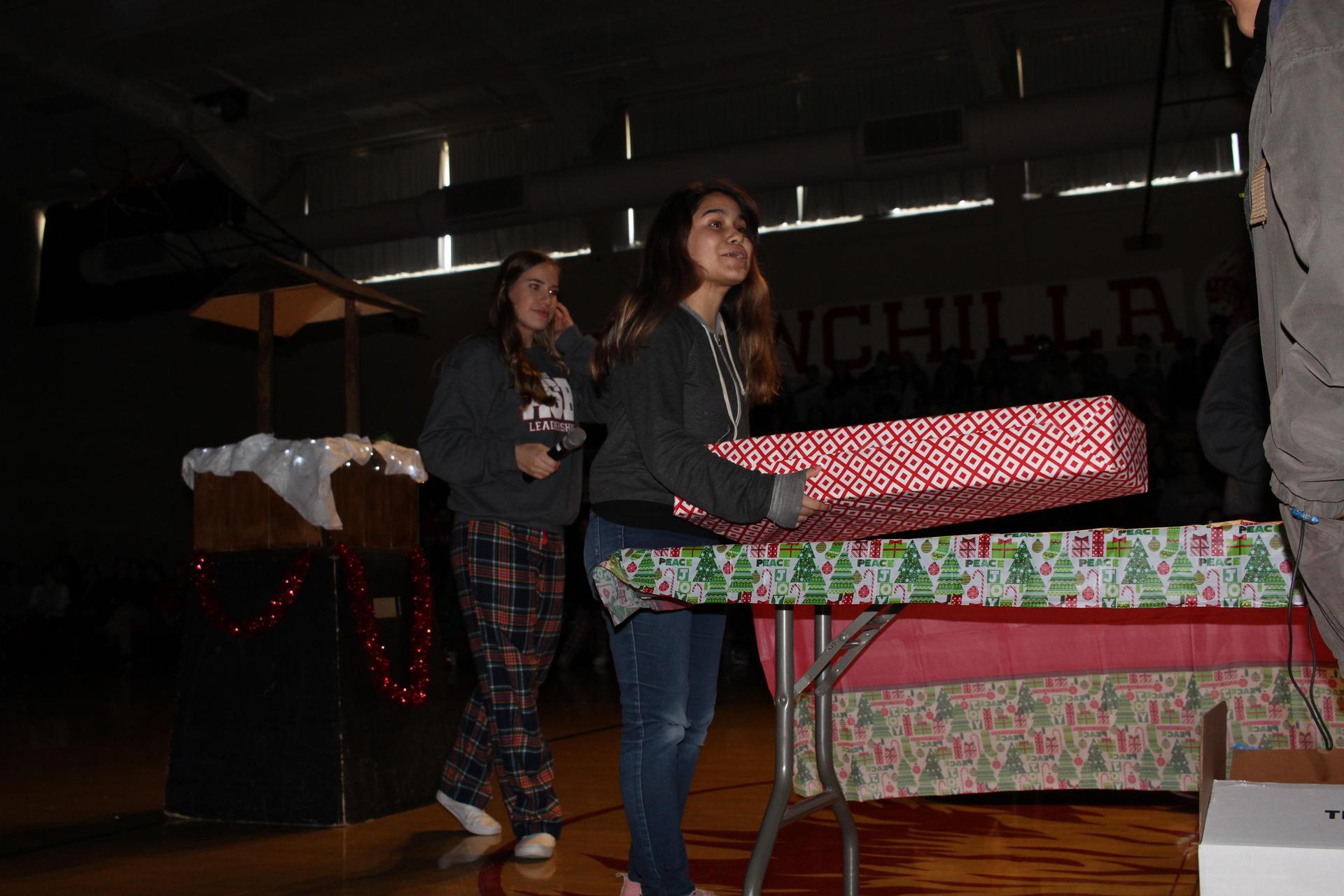 Alyssa Alfaro  opening her gift