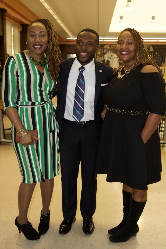 Ms.Wyre and Ms.Grey with a man smiling