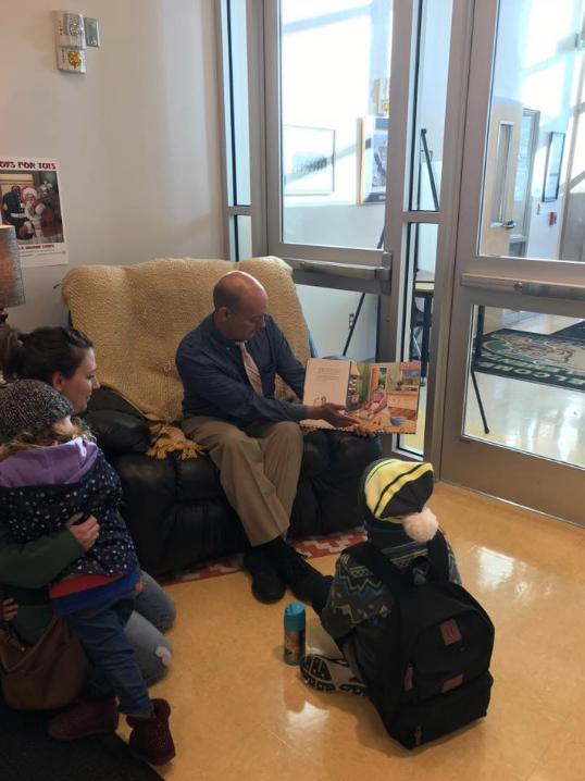 principal reading to guests