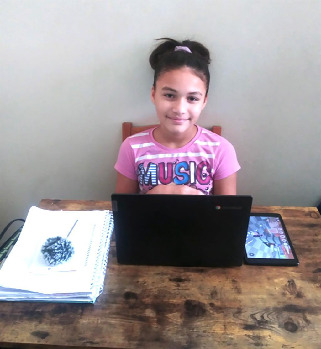 A smiling student at her new desk