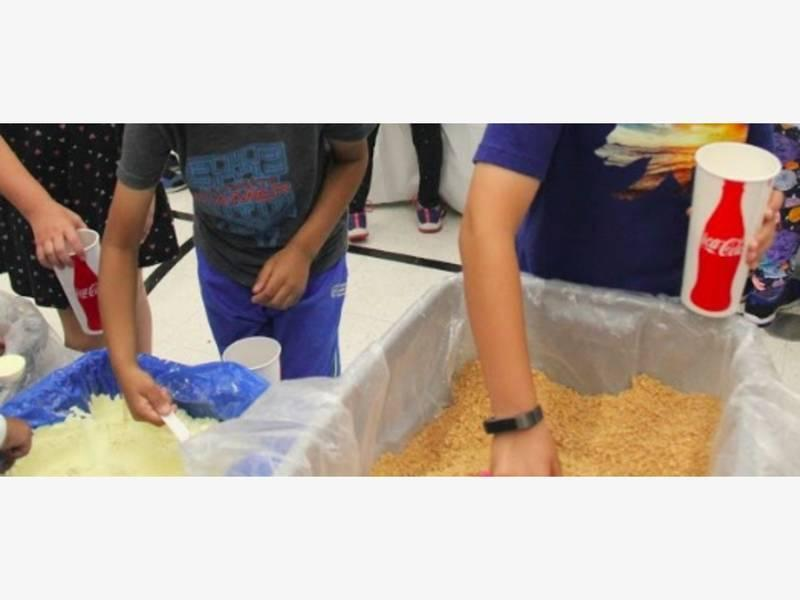 Kids Against Hunger - students pack food for hungry people.