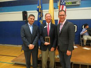 "During its annual Veterans Day assembly on Nov. 11, Roosevelt Intermediate School honored Helmuth Meditz, who served 5 years in the U.S. Army National Guard, with the ""Heroes Among Us"" award.  Mr. Meditz is pictured here with Roosevelt principal Brian Gechtman (left) and teacher/assembly coordinator Brian Vieth."