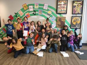 4th grade students and their artwork