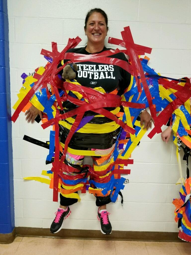 Dr. Shulsky taped to wall.
