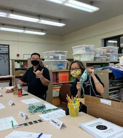 Teachers opening box of masks