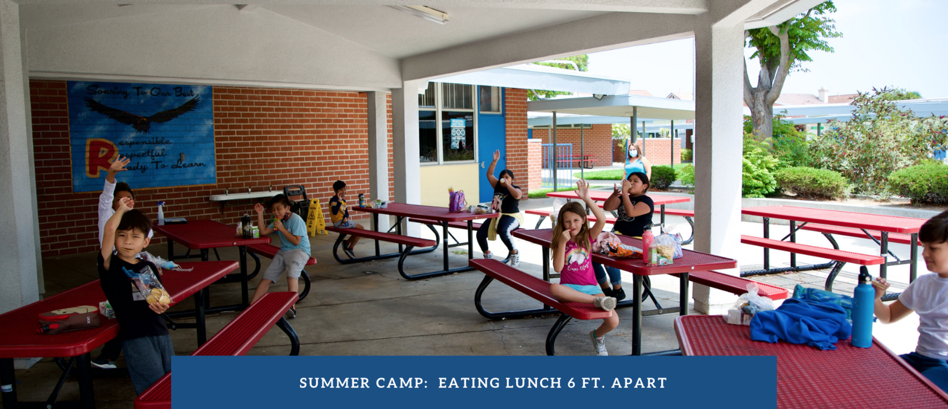 Observing social distancing while in eating lunch at summer camp