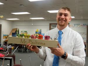 McFall Elementary teacher Jacob Bultema shows off his crayon holder organizing different colors.