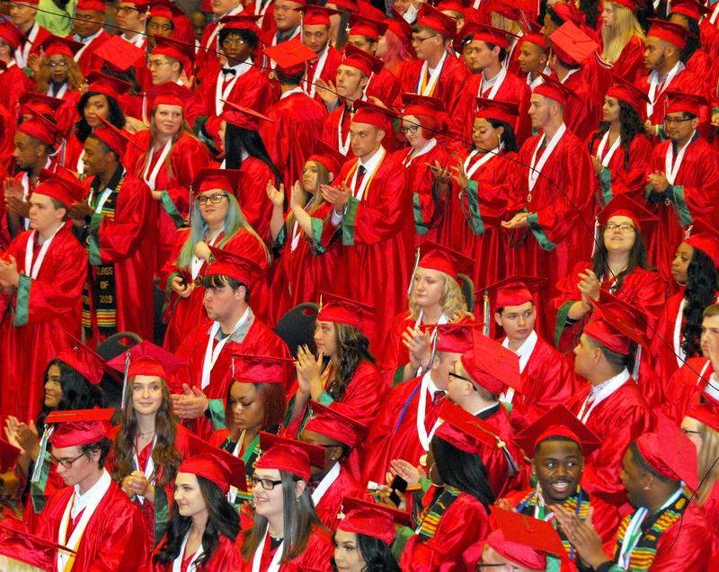 A sea of AHS graduates in red caps and gowns