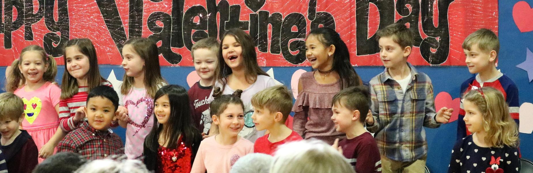 First graders enjoy a Valentine's Day singalong at Washington School.