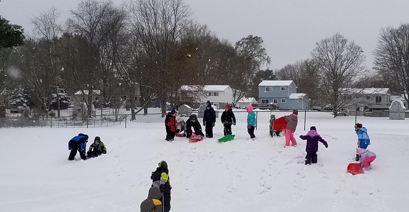 McFall students love sledding down the hill on the playground.