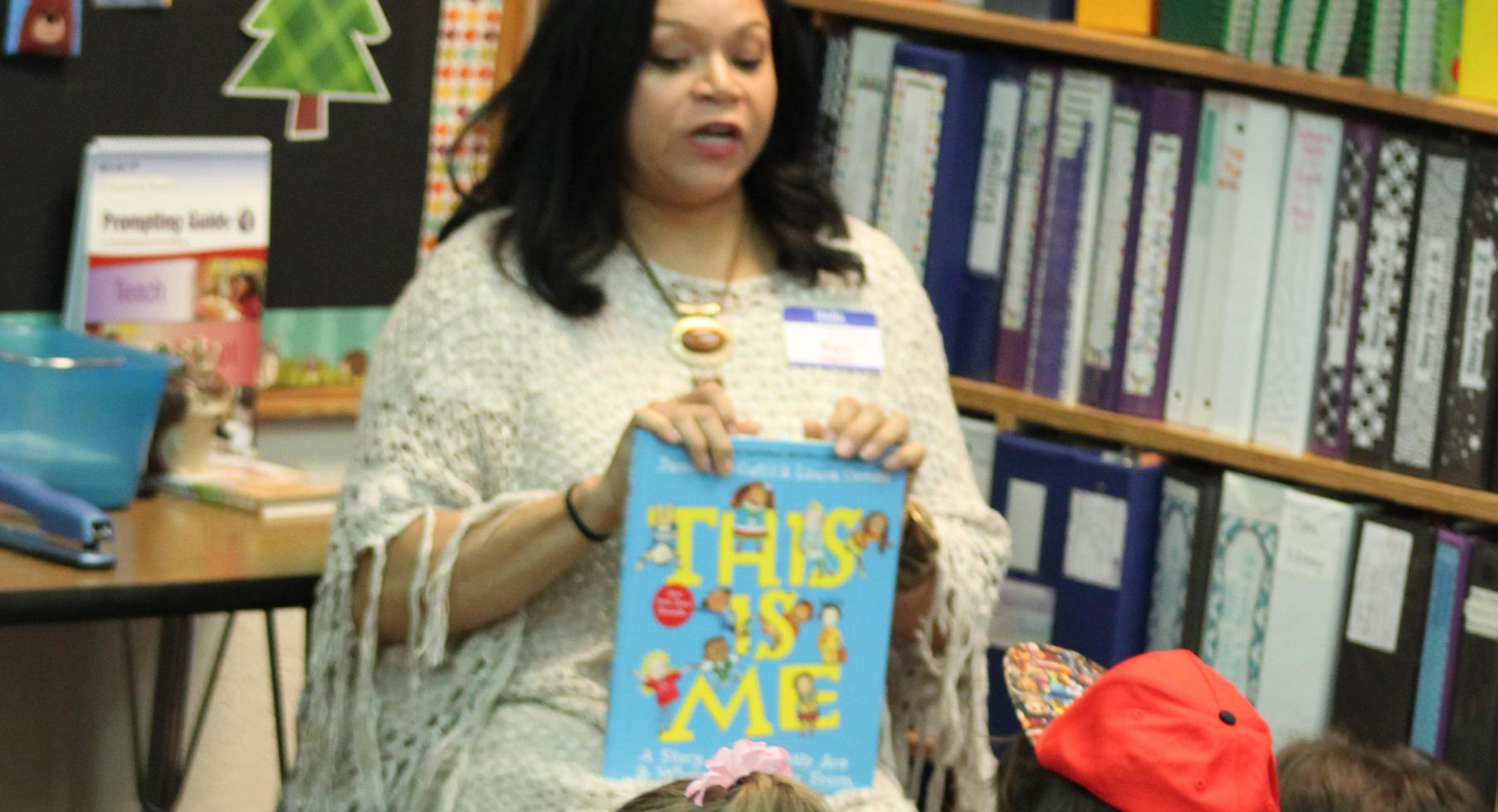 Angelia Manuel reads to students.