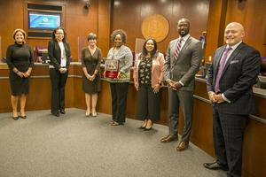esc4_presents_plaque_to_board_102020.JPG