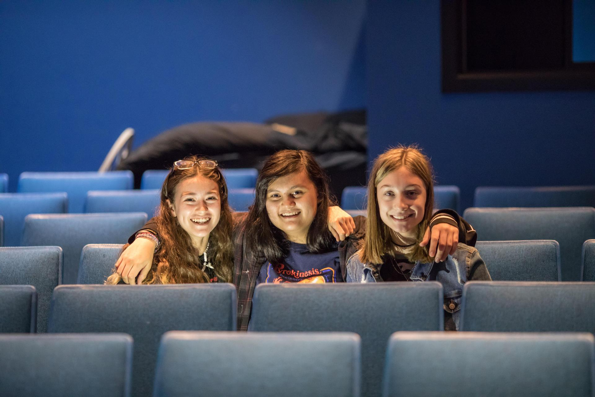 students smiling in the theater