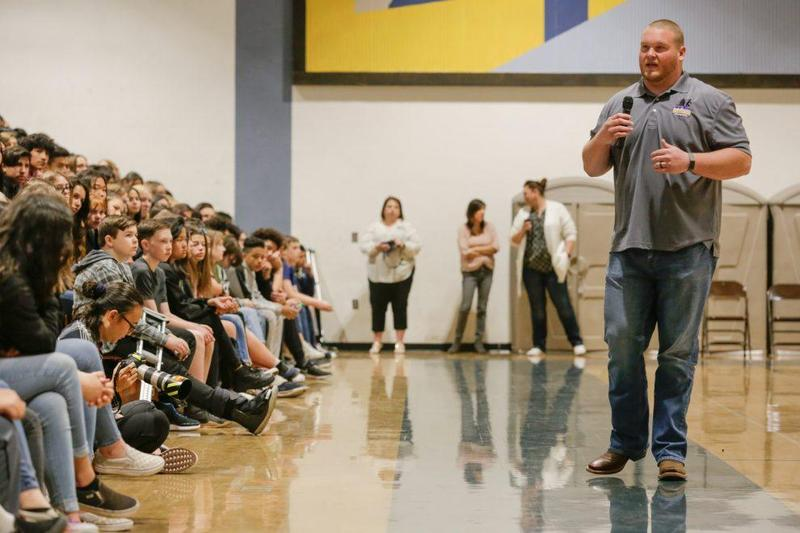 Bradley Bozeman speaks to teens about maintaining a positive attitude in the face of challenges and obstacles in way of goals and dreams inside the gym at Castaic Middle School, Wednesday, Feb. 26, 2020. Gilbert Bernal/The Signal