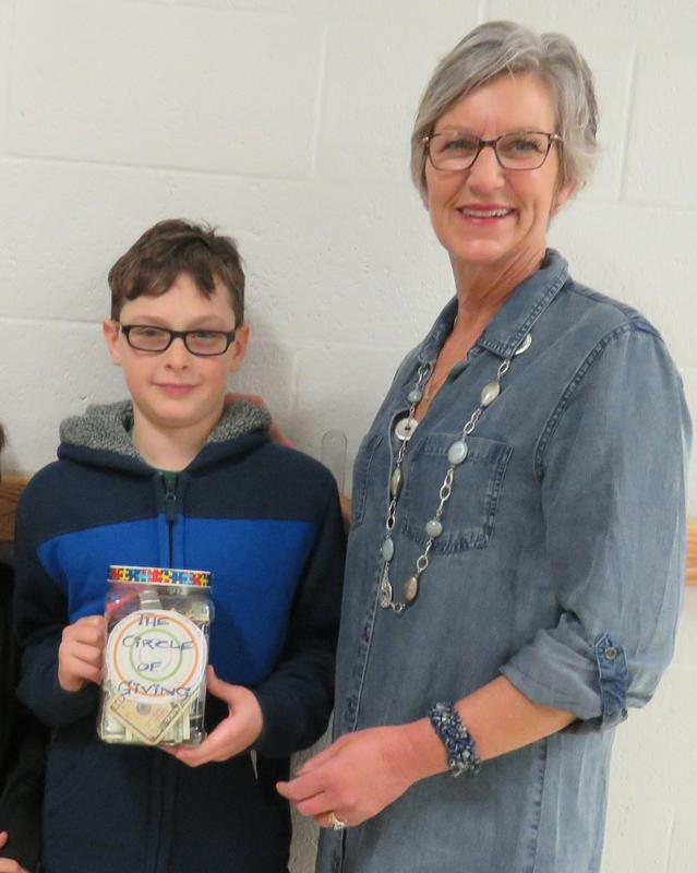 A Page student presents a donation to a local charity.