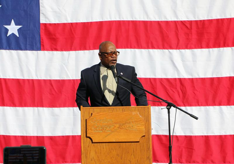GCTC staff member Clarence Prevost address crowd at Veterans Day Assembly.