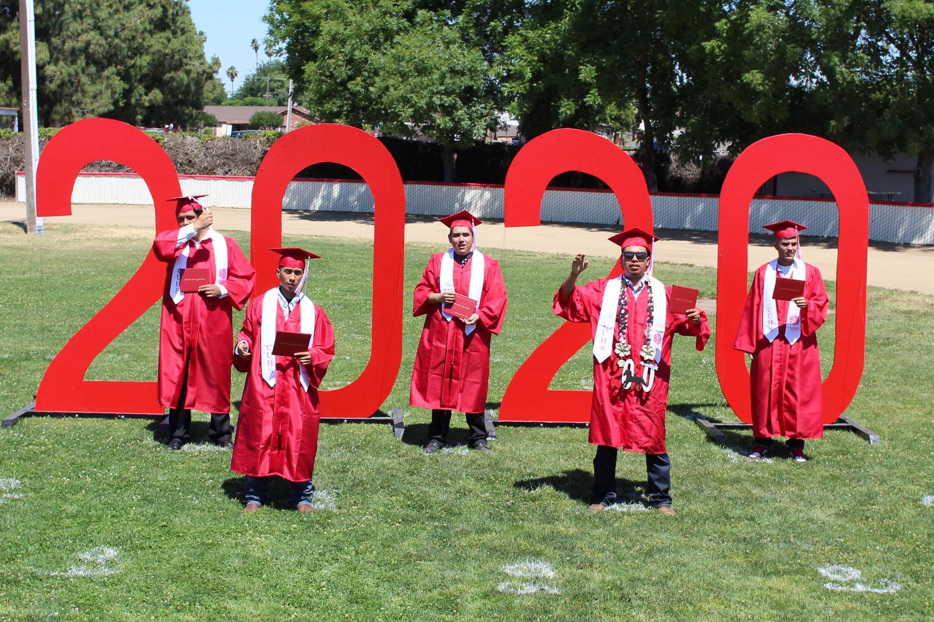 Left to right, Cesar Rojo Perez, Brian Lara, Daniel Christobal Naranjo, Miguel Lara, and Oscar Orozco turning their tassels