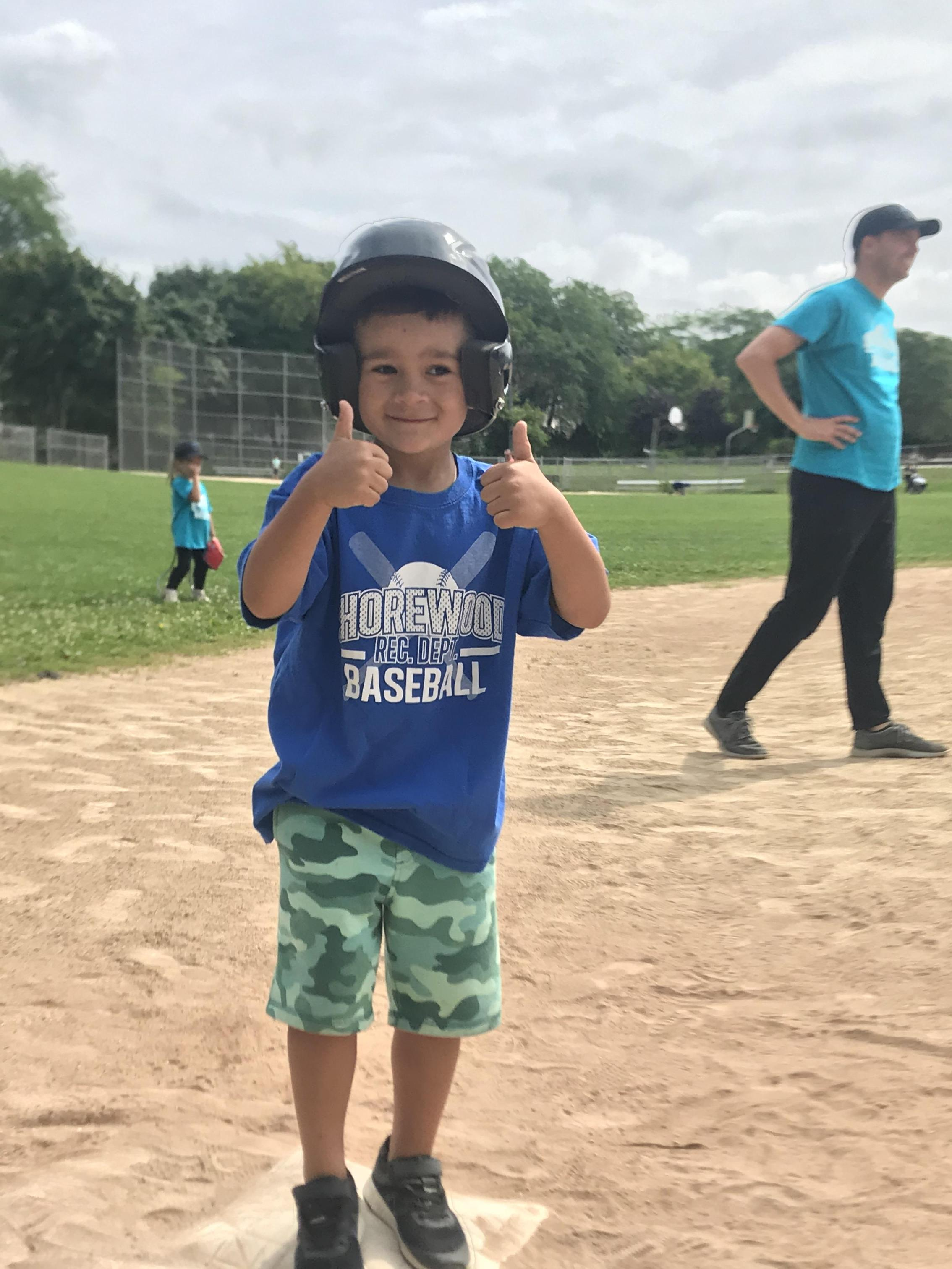 T-ball player thumbs up