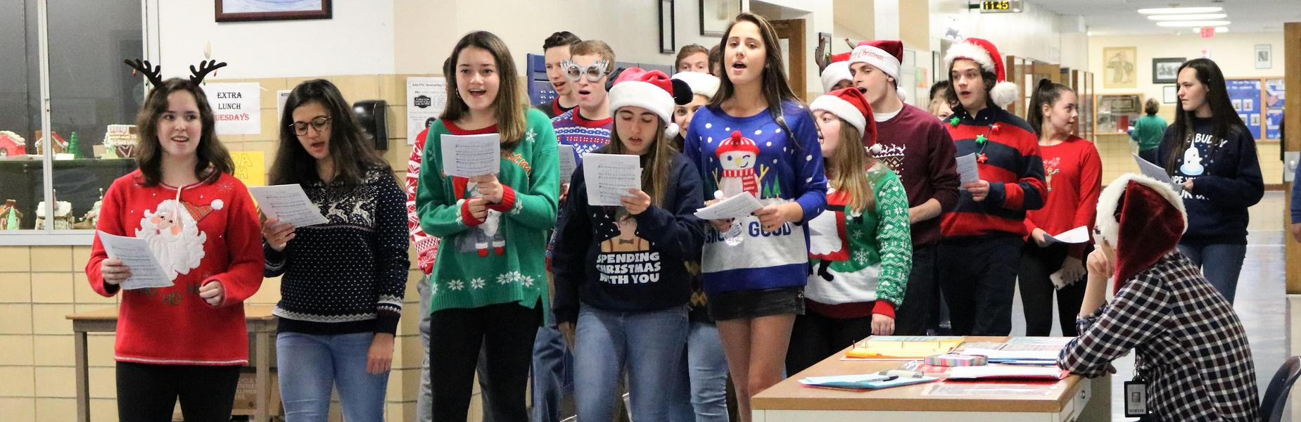 The WHS Chorale takes to the hallways to sing carols to fellow students and staff.