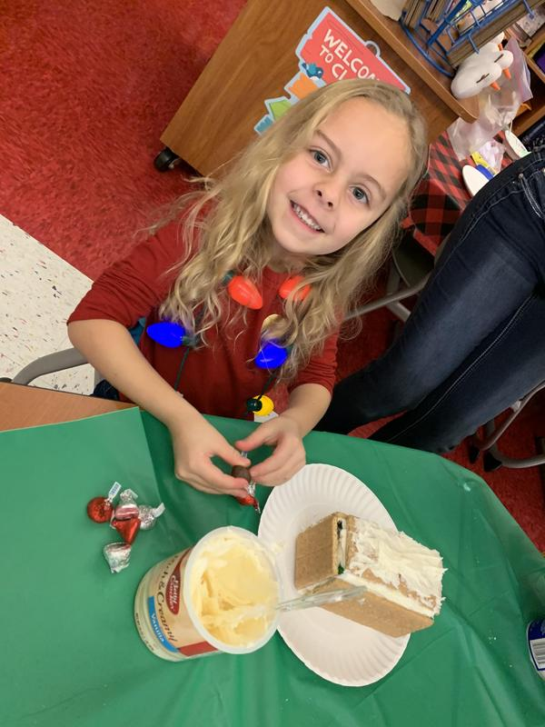 pic of girl making gingerbread house