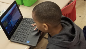 Boy on a laptop.