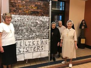 photo of Felician Sisters with Mission & Heritage week bulletin board