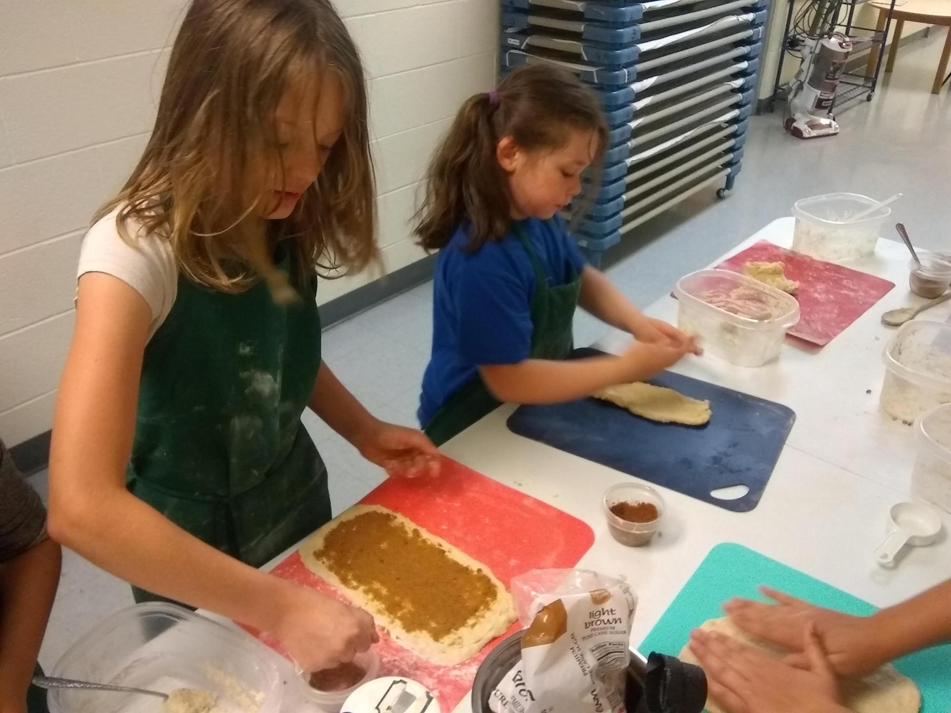 kids making cinnamon rolls from scratch