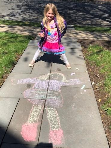 Photo of Lincoln preschooler and chalk self-portrait.