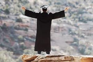 Graduate on mountaintop