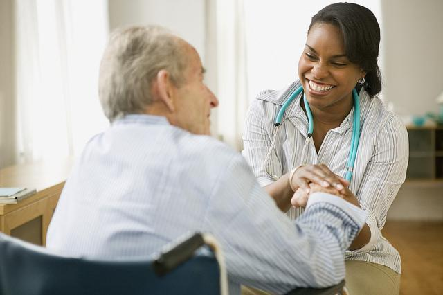 Nurse Assistant helping patient